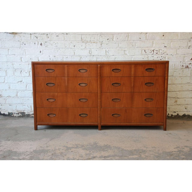 A beautiful Mid-Century cherrywood eight-drawer dresser or chest of drawers designed by Michael Taylor for the New World...