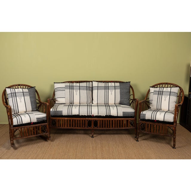 Classic East Coast Americana loveseat with cushions made of Injiri organic cotton textiles from India. Textile has areas...