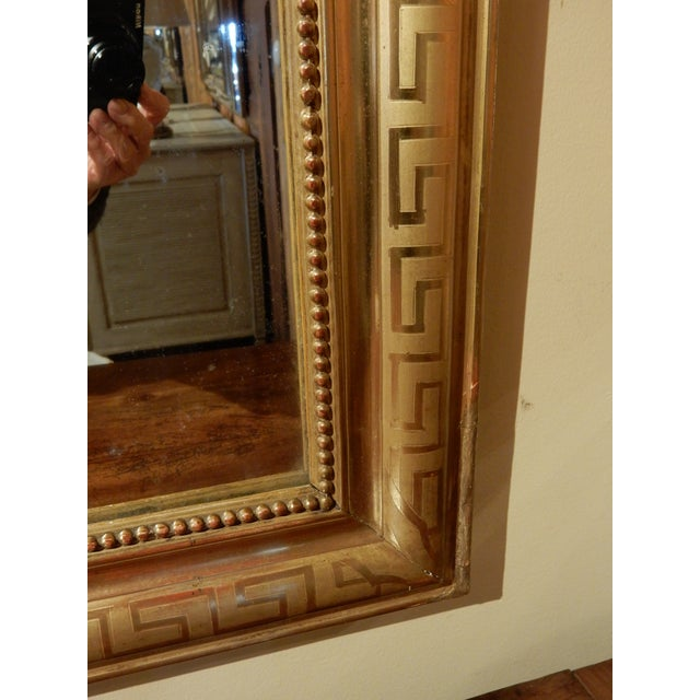 Beautiful Louis Philippe mirror with Greek Key etching. High-quality gold leafing enhances this mirror.