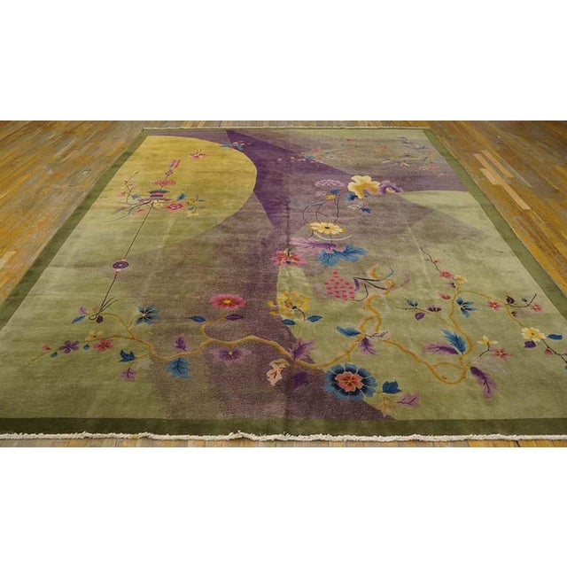 This is a Chinese art wool rug from China 1920. The colors are green, purple, yellow, blue, cream, and tan. There are...