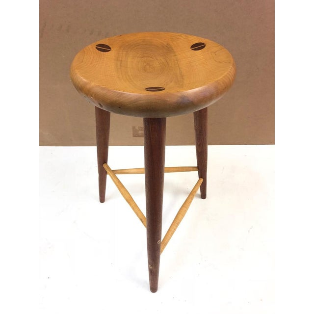 Pair of walnut and maple studio stools. Style of Wharton Esherick.