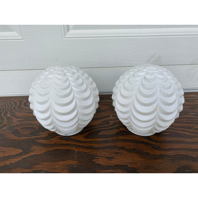 A pair of beautiful scalloped / textured mid-century modern frosted white glass lamp globes. The opening where these...