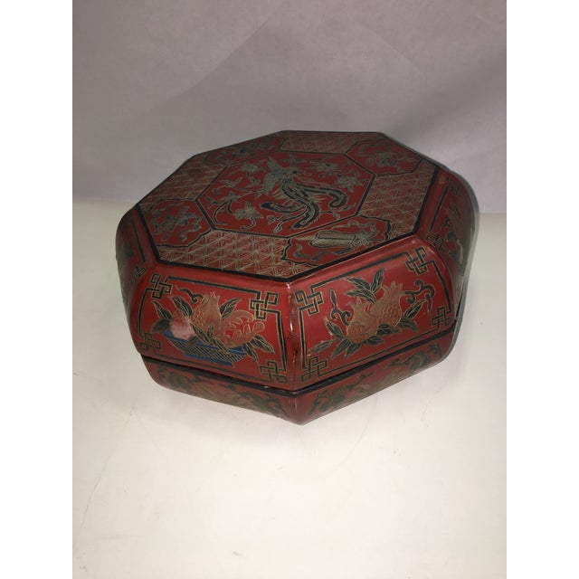 A beautiful old Chinese red lacquer box with gold and black decorations. Octagonal shape. In almost perfect shape. A...