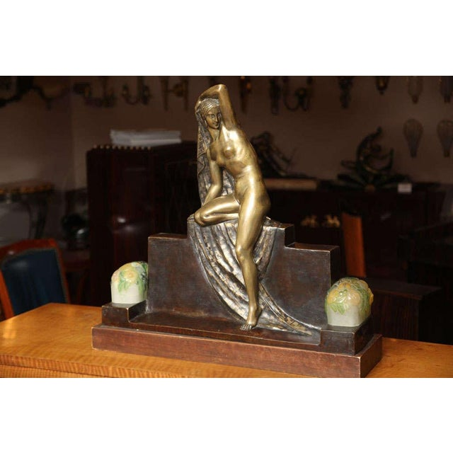 Fanny Rozet (French, 1881-?) Art Deco figural lamp representing a draped nude bronze figure with two pate-de-verre shades...