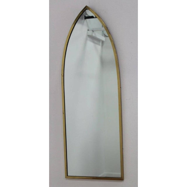 Pair of Mid-Century Modern brass arched mirrors.