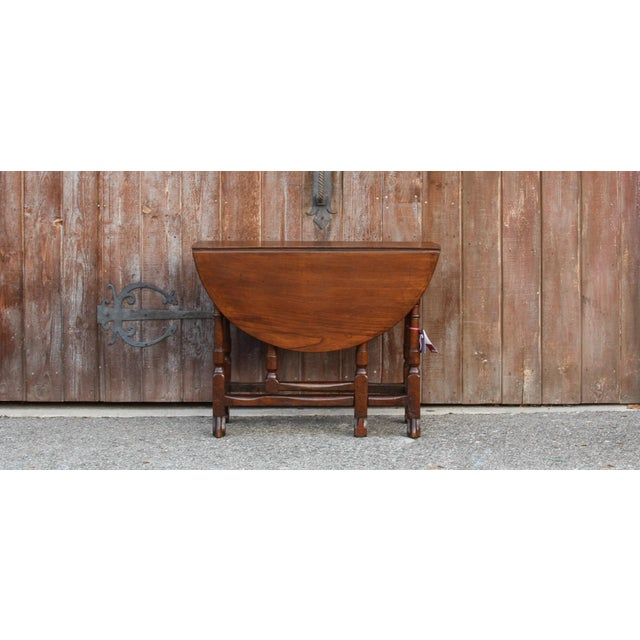 Originally used as a breakfast folding gate leg table, this antique piece can now only be used as a console as it is...