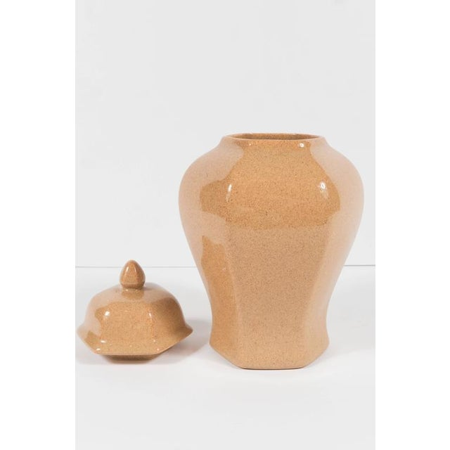 This rounded hexagonal form stylized ginger jar has a beautiful sand colored glaze and is signed Tiffany on the bottom ....