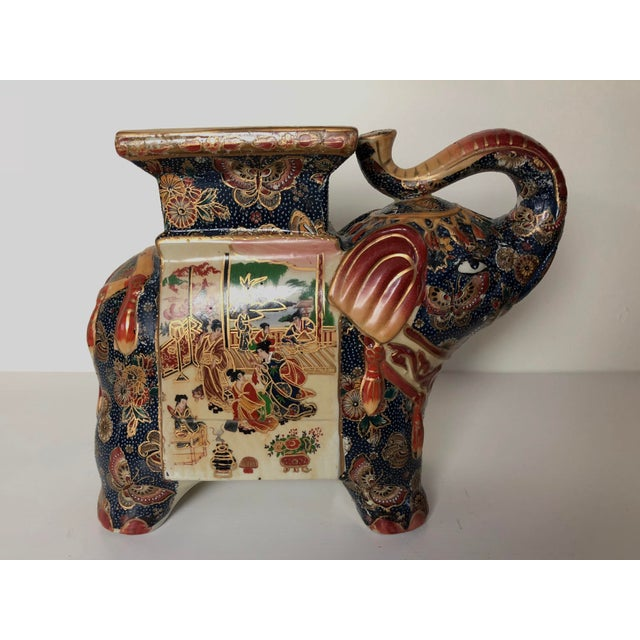 A vintage Asian style hand-painted ceramic plant stand or decorative room accessory. In excellent vintage condition