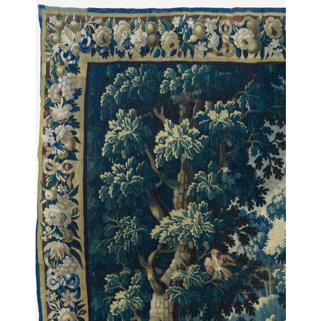 This is a gorgeous antique square 17th century flemish Verdure landscape tapestry with birds depicting a beautiful and...