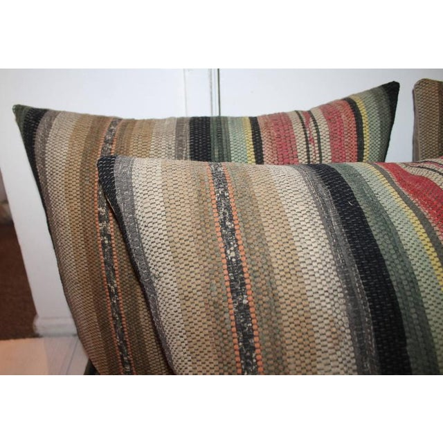 These early American rag rug pillows have cotton tan linen backings and are down and feather fill. Sold in pairs. Three...