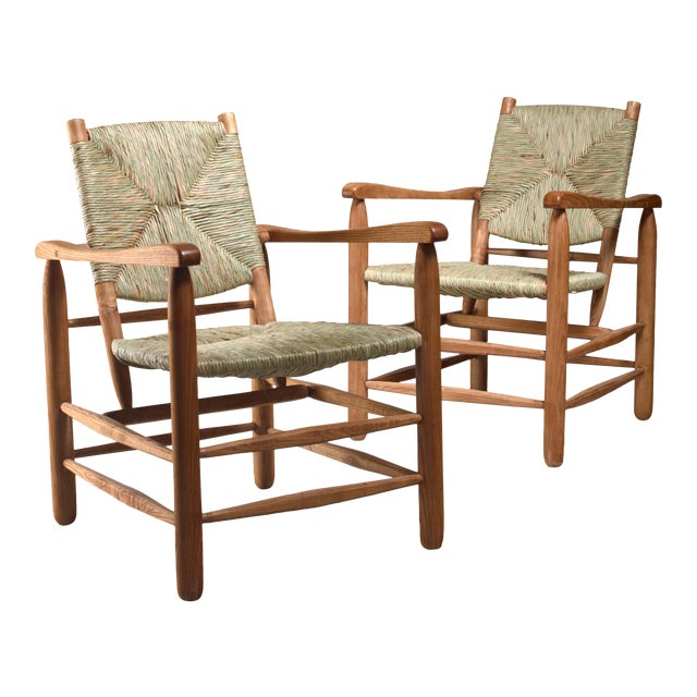 Pair Charlotte Perriand 'model no. 21' lounge chairs France 1950s For Sale