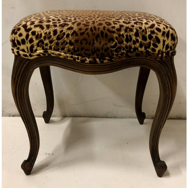 Pair of 1930s French oak ottomans in vintage leopard velvet upholstery. They are in good condition.