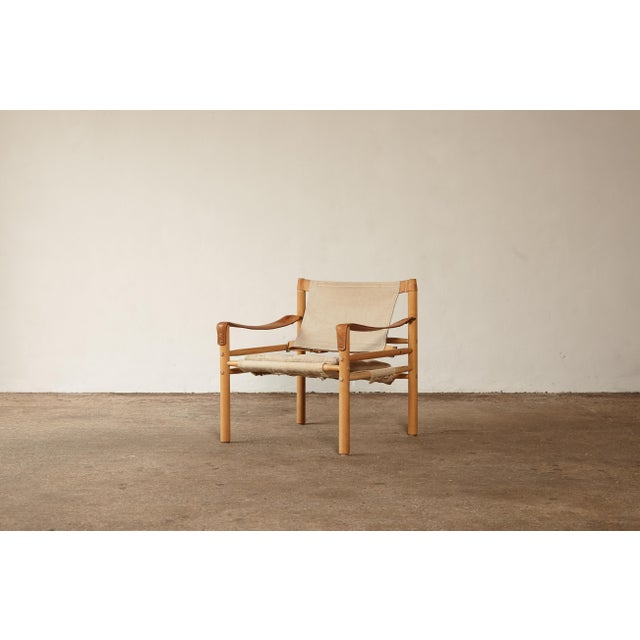 An Arne Norell safari sirocco chairs in ashwood and original canvas. Made by Norell Möbel AB, in Sweden. Good vintage...