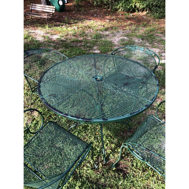 20th century Russell Woodrow style mesh patio dining set. Four curve chairs with floral design on edge. Very little paint...