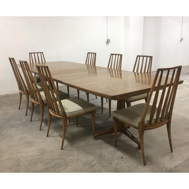 Stunning Mid Century John Widdicomb Dining Table with 8 chairs. Excellent condition showing minor wear due to age and use.
