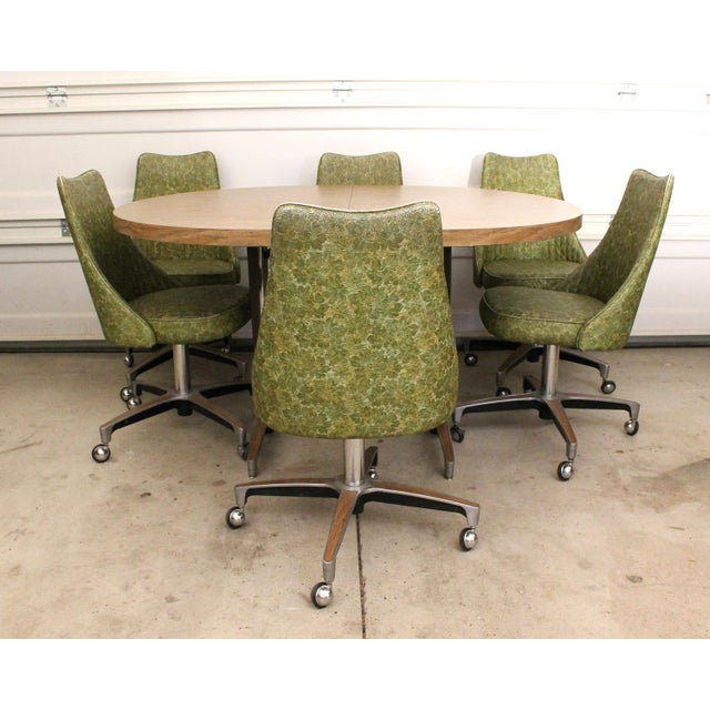 A super late 60s to early 70s Chromcraft dinette set with 6 chairs and a laminate table with extension leaf. The table...