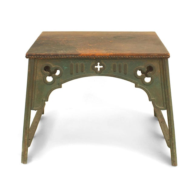 Late 19th century English Arts and Crafts rectangular green painted iron coffee table with a brown leather top.