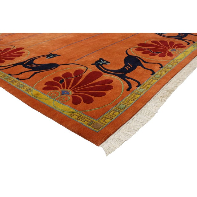 Infuse your space with this vintage Tibetan orange rug with black cats. Combining the ancient Tibetan art with...