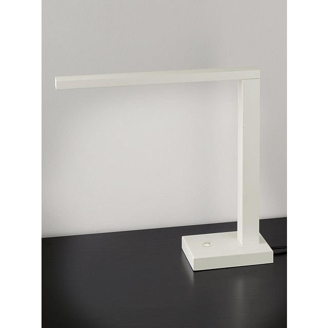 Soft white desk lamp with a rectangular top arm that swivels 180 degrees and provides a powerful integral LED reading...