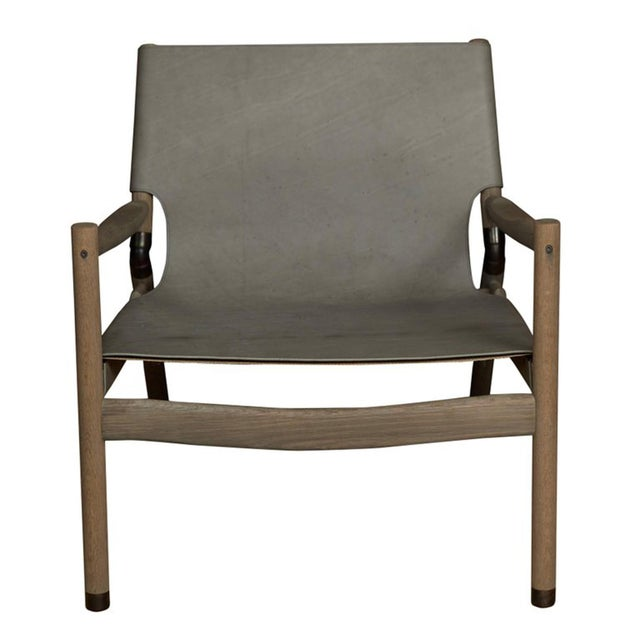 "Erickson aesthetics slung leather greyed oak lounge chair. Seat height-15"" Custom orders have a lead time of 10-12 weeks..."
