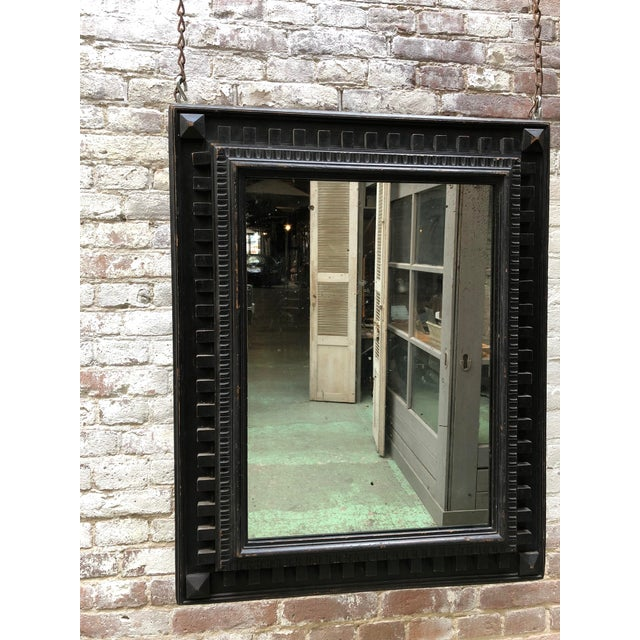 Nice wood carved Black Italian mirror with its original mercury glass.