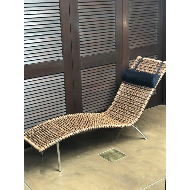 Modern styled (interior) multi-toned wicker chaise lounge with black removable head rest in perfect condition. The...