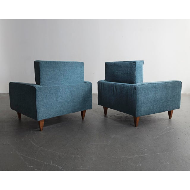 Pair of lounge chairs with wood frame and turquoise blue upholstery. Designed by Joaquim Tenreiro, for a private...