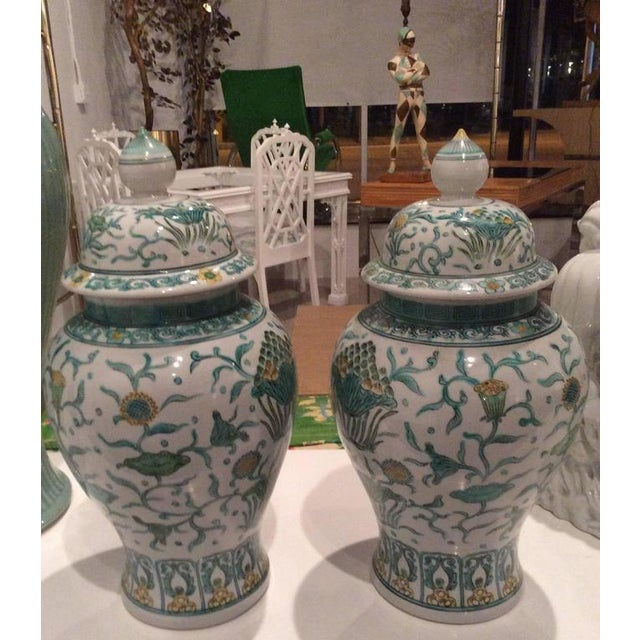 The prettiest pair of Oriental, Asian Ginger Jars with a lovely green and yellow color palette. Great Greek Key design...