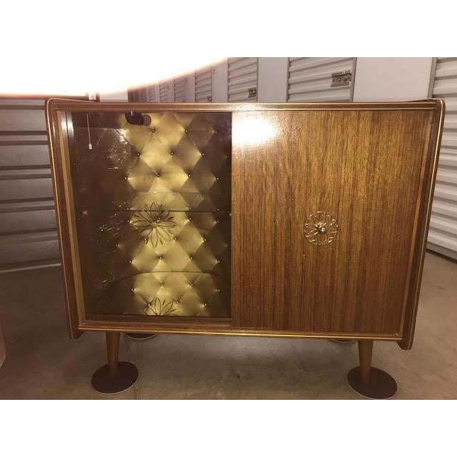This fabulous, vintage Mid-Century dry bar has tons of character that will make it a great addition to any home. The dry...