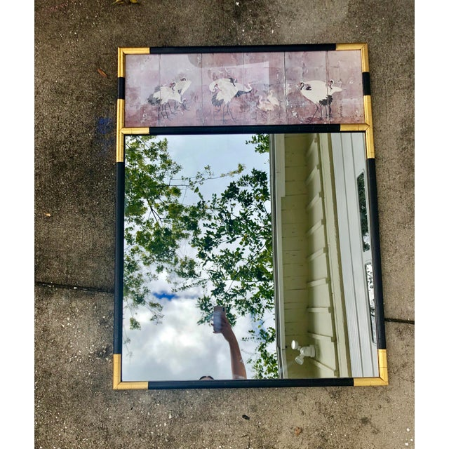 Vintage oversized mirror made of wood (very heavy) with black and gold accents and a top panel made of laminate depicting...
