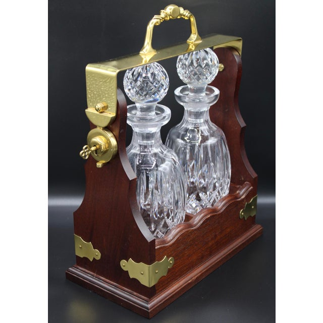 Large, 1960s Irish Waterford Crystal Decanters in Walnut Tantalus by designer John Connolly. This is a fully functioning...