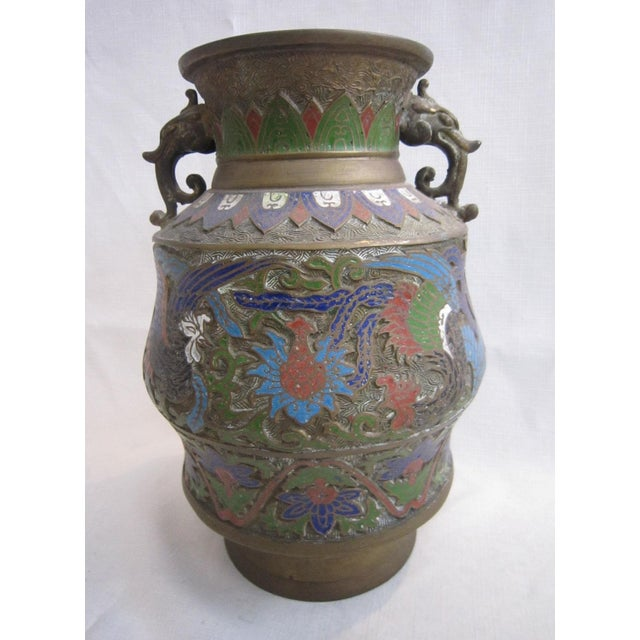 Chinese dragon handled vase with champlevé enamel work on all sides. Incredible detail!