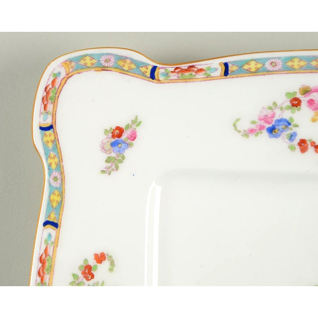 Minton Square Serving Platter (Pattern # B806) features multi color floral swags and center design with mustard yellow...