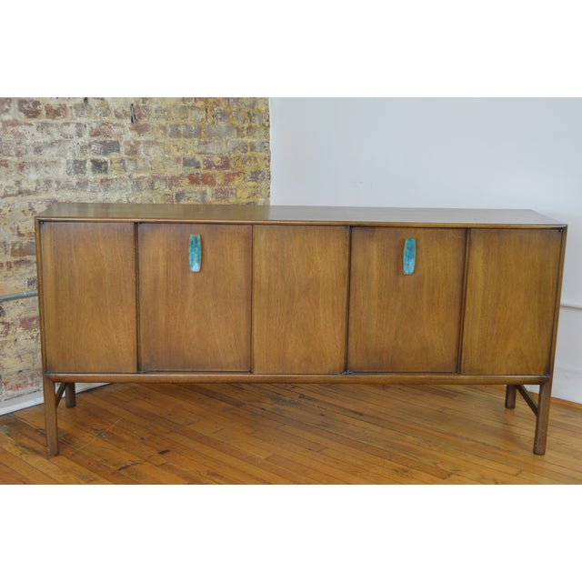 One of the more striking and well made pieces we've offered, this credenza is constructed of bleached mahogany and...