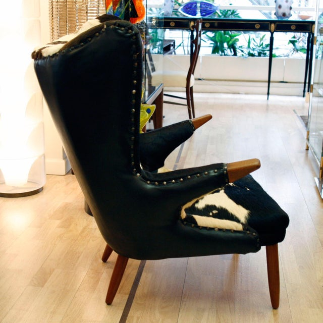 Svend Skipper designed wing armchair, original pony hide upholstery wing armchair. 1950s Denmark
