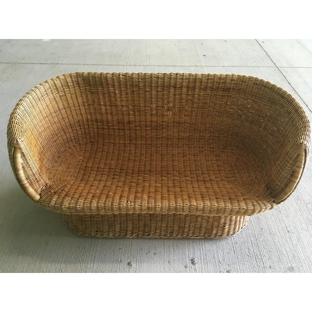 Amazing boho vintage barrel back wicker settee. Perfect for a sitting area or sunroom. Two settees are available and are...
