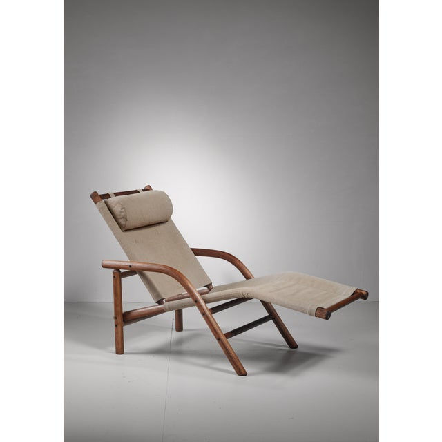 A Ben af Schulten lounge chair or chaise longue for Artek, Finland. The chair is made of bent birch with a canvas seating...