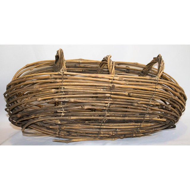 Woven twig basket as found in Big Bear, CA. Local artisans are known for basket weaving in this area using indigenous...