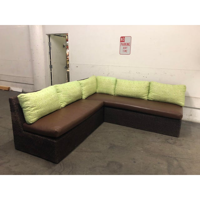 Design Plus Gallery presents a two-part sectional from Walter's Wicker Works. A sloped back, open ends and firm leather...