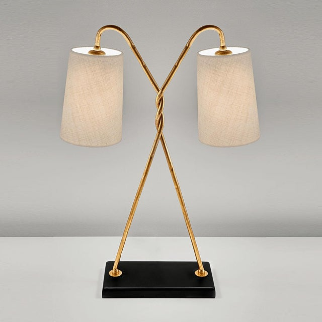 Florentine antique gold leaf table lamp with shade. Hand wrought iron tubing with a distressed patina formed into a...
