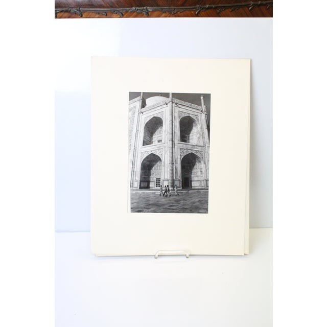 Black and white matted photograph focusing on the architecture of the Taj Mahal.