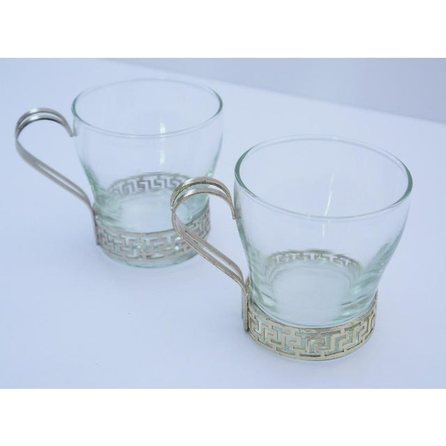 This set contains a pair of glasses framed with metal key pattern around base and handle. Art Deco pair are in excellent...