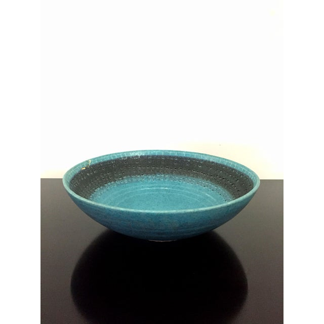 A really great vintage Raymor Italian bowl by Raymor. This one in the blue/black color scheme. Comes with a small repaired...