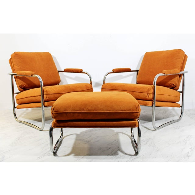 For your consideration is a remarkable pair of rare, tubular chrome, lounge chairs, and matching ottoman by Milo Baughman....