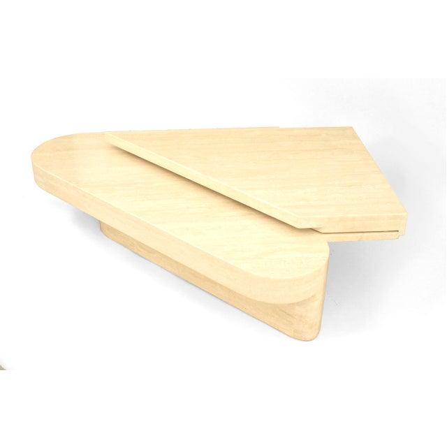 1980s American two-tier triangular geometric form travertine coffee table.
