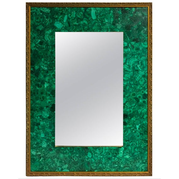 A spectacular and very unique burl malachite veneered and parcel-gilt bevelled mirror. This rectangular shaped bevelled...