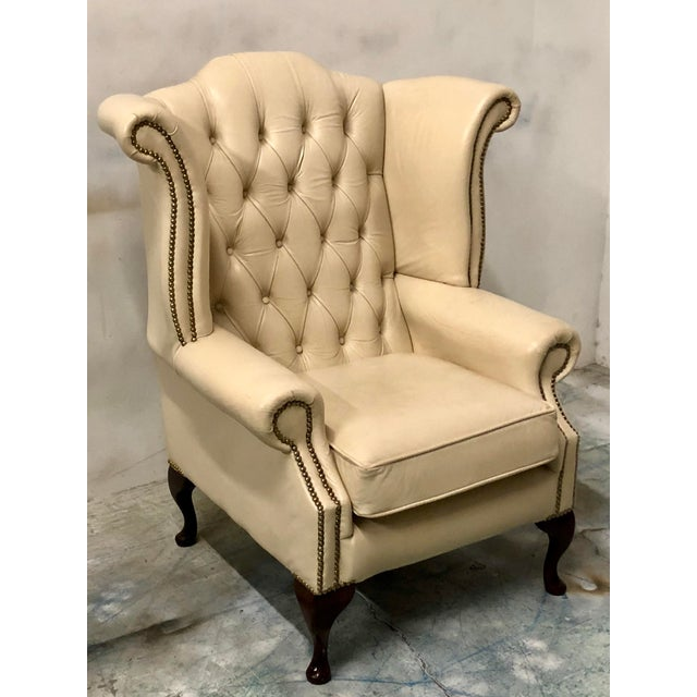 Englisg leather wing chair with chippendale styling. It dTes to the 50s or 60s. It is in very good condion and unmarked....