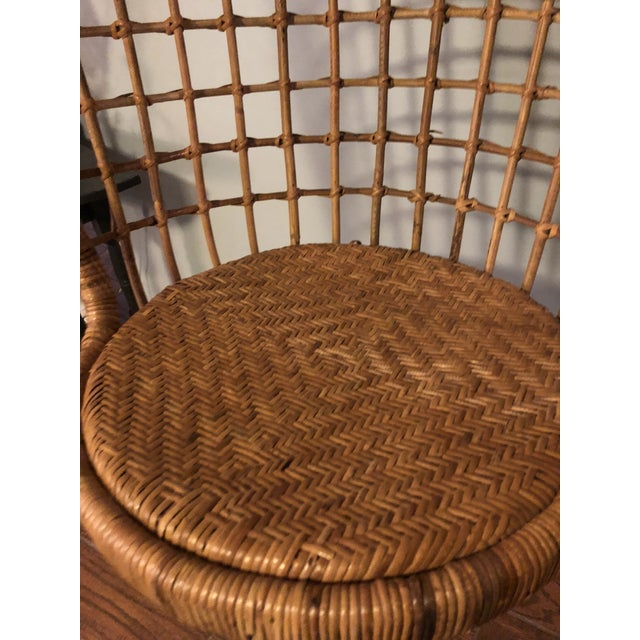MidCentury bamboo rattan hanging chair . Bought in 1970s and has the spring that goes on end of chain. Great boho style...