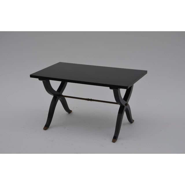 Chic French 40's Lacquer Small Coffee Table or Side Table. Black lacquer and brass sabots. In the style of André Arbus.