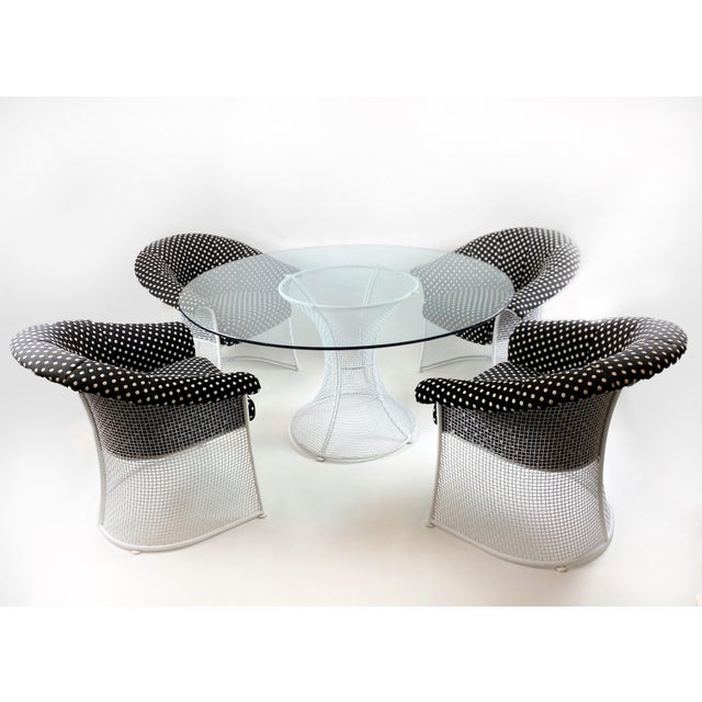 A fabulously rare black and white polka dot patio set by Russell Woodard, circa 1950s. Frames of wrought iron, with...